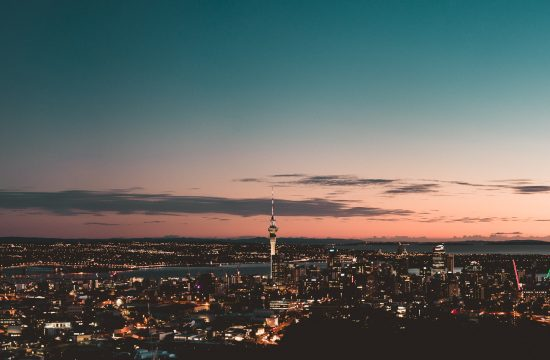 a panorama of auckland city at sunrise taken from mount eden