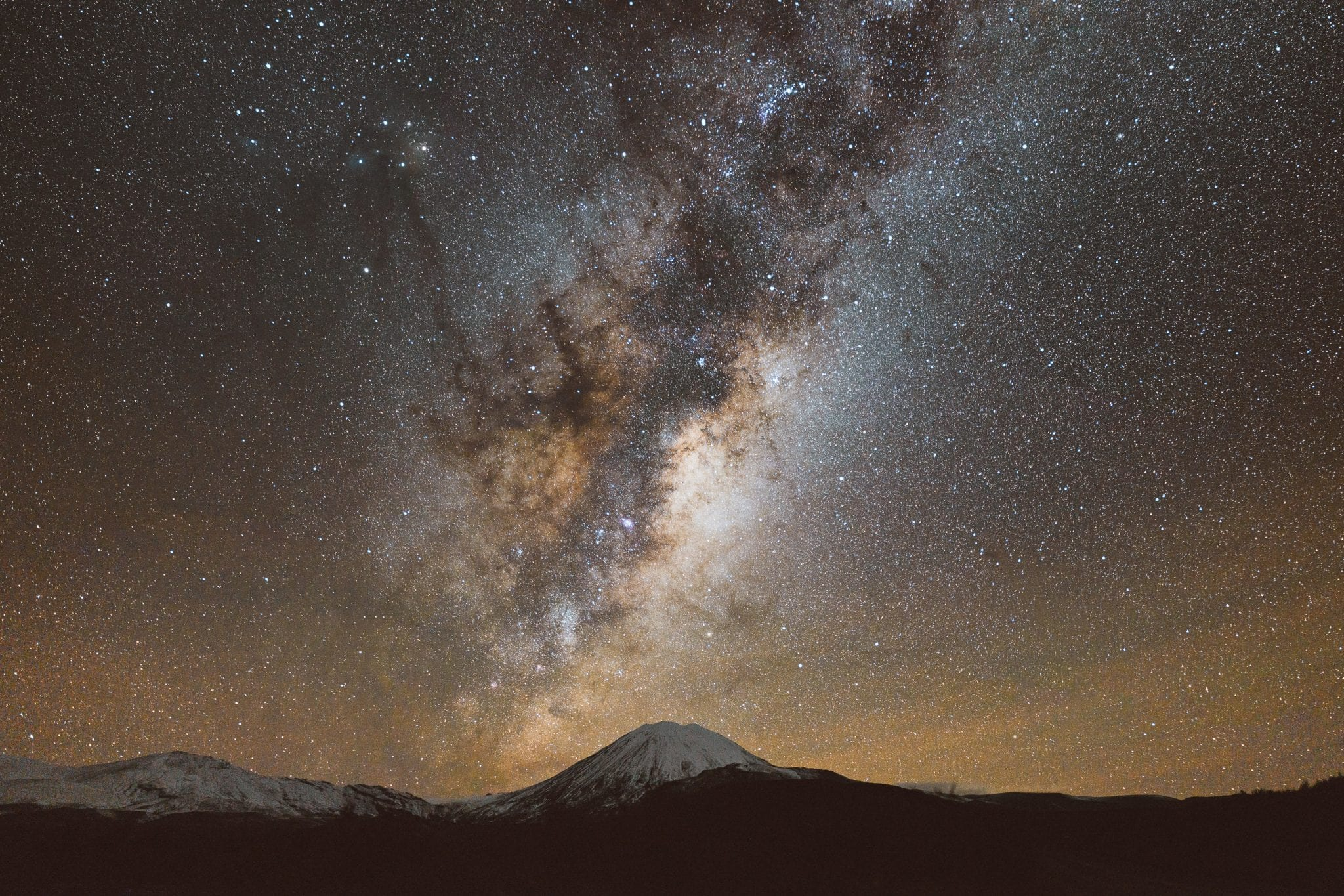 the Milky Way rising above mount ngauruhoe and mount tongariro