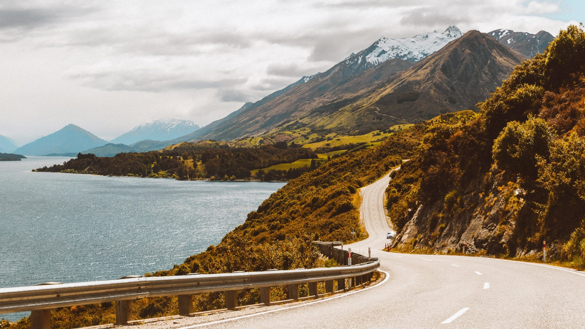 a car driving along the windy road to glenorchy